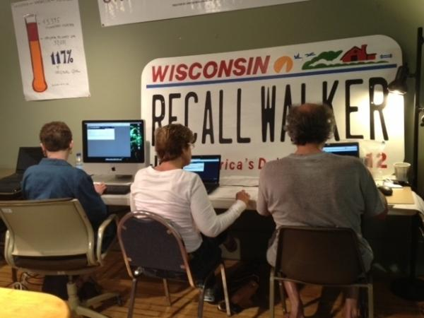 Volunteers at the Wisconsin Democratic Party's recall office in Waukesha entered names from petitions to recall Gov. Scott Walker into their voter databases on March 20.