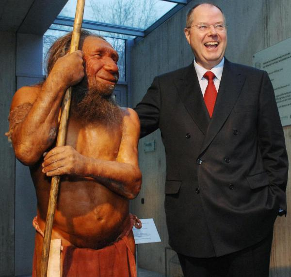 "What if we still stood side-by-side? Former German Finance Minister Peer Steinbrueck poses next to a Neanderthal model at the <a href=""http://www.neanderthal.de/en/"">Neanderthal Museum</a> in Mettmann, Germany, in 2007."