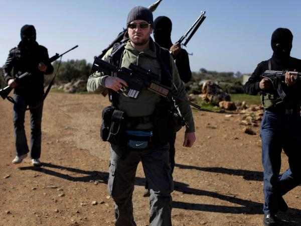 "Syrian rebels, headed by their leader nick named "" Abu Suleiman"" in the north of northern Syria's Idlib region, on March 18, 2012. Saudi Arabia is delivering military equipment to Syrian rebels in an effort to stop bloodshed by President Bashar al-Assad's regime, a top Arab diplomat said."