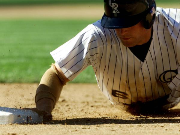 Ben Petrick dives into the plate during a 2001 game against the San Diego Padres at Coors Field in Denver, Colo.