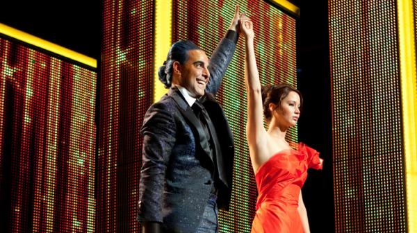 <strong>Are You Not Entertained?</strong> TV host Caesar Flickerman (Stanley Tucci) takes the celebrity interview to new lows when chatting up the young combatants in the to-the-death Hunger Games — including Katniss Everdeen (Jennifer Lawrence).