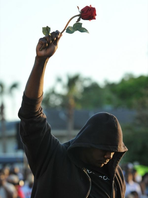 James Gilchrist of Orlando, Fla., attends a rally for slain teenager Trayvon Martin in Sanford, Fla., on Thursday. Trayvon was wearing a hoodie when he was shot.