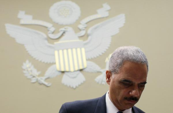 "Attorney General Eric Holder arrives at a House Oversight and Government Reform Committee hearing on Feb. 2. Holder says, ""The Civil Rights Division ... is the conscience of the Justice Department."""