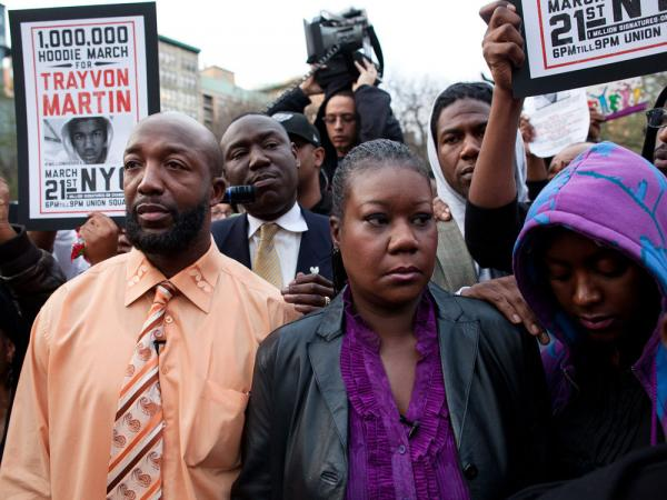 Trayvon Martin's parent's Tracy Martin, left, and Sybrina Fulton, center, are joined by an unidentified woman during the Million Hoodie March in Union Square Wednesday, March 21, 2012 in New York. Our first hour today explores how the conversation about race has changed since the death of Trayvon Martin.