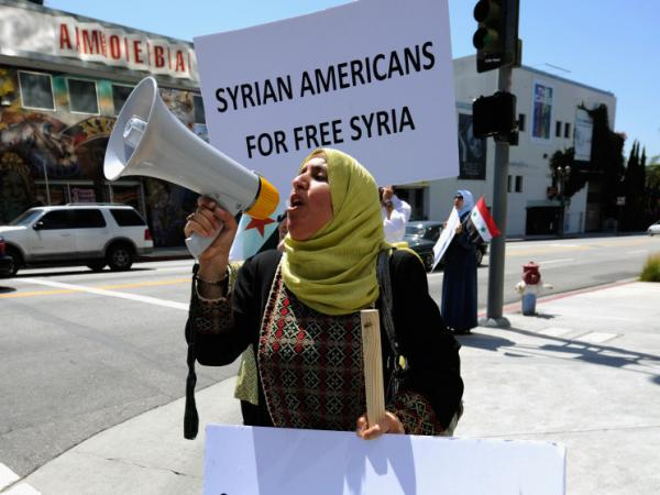 Nahida Al Khairat holds a protest sign during a demonstration against the Syrian regime in front of the CNN Los Angeles building on June 3, 2011 in Los Angeles, Calif.