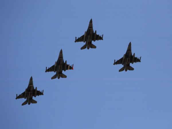 Four F-16's fly over during the national anthem before the NASCAR Sprint Cup Series SUBWAY Fresh Fit 500 at Phoenix International Raceway on March 4, 2012 in Avondale, Arizona.