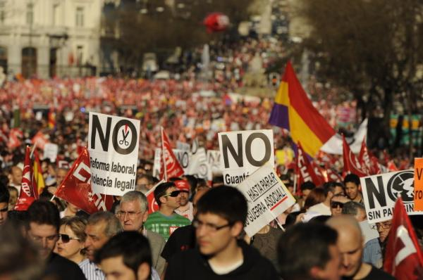 People attend a demonstration in Madrid on Thursday during a national strike.
