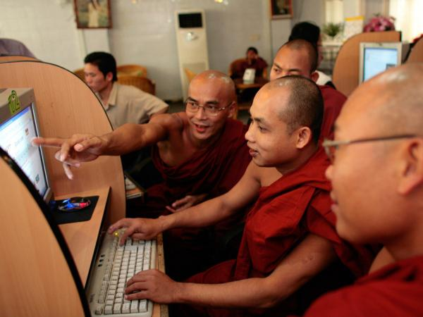 Burmese monks work on computers reading Buddhist websites at a local internet cafe February 22, 2007 in Mandalay, Myanmar. The internet is strictly controlled by the government banning all free email services such as Yahoo, Hotmail and AOL.
