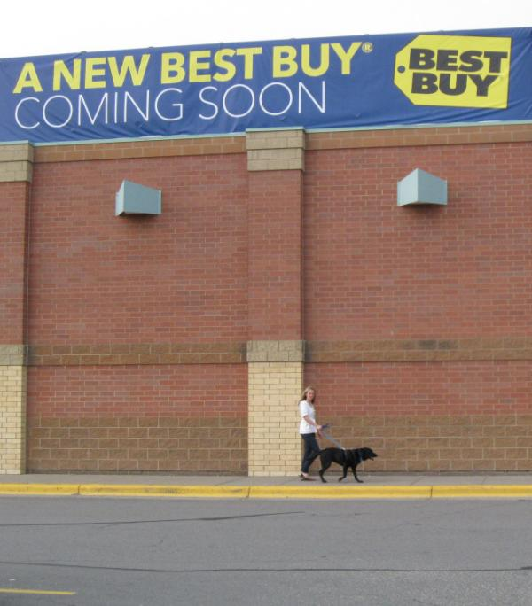 Outside the Richfield, Minn., store on Thursday, a banner announces the coming changes.