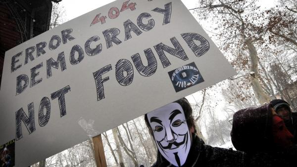 The group Anonymous has threatened to take down the Internet on Saturday to protest anti-piracy proposals that they consider online censorship. Here, a masked protester demonstrates against one such measure last month in Zagreb, Croatia, last month.