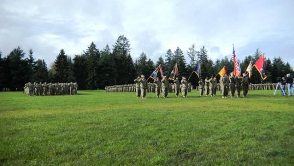 "Members of the 2nd Stryker Brigade at Joint Base Lewis-McChord prepare to ""case"" their flags in preparation for a nine month deployment to Afghanistan. Photo by Austin Jenkins"