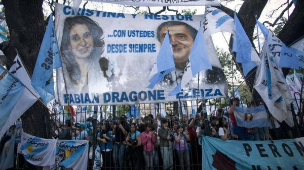 <p>Images of Argentina's President Cristina Fernandez and her late husband, former President Nestor Kirchner, loom over supporters at a campaign rally in Buenos Aires on Wednesday.</p>