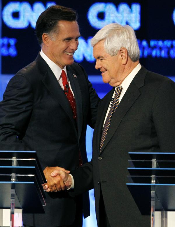Republican presidential candidates Mitt Romney (left) and Newt Gingrich shake hands after a Republican presidential debate in Tampa, Fla.