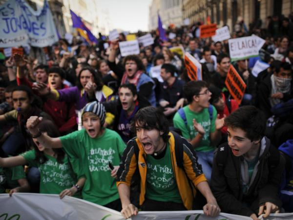 The clashes in Valencia triggered protests across Spain. Here, students protest in Madrid on Wednesday.