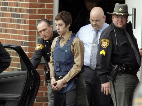 In this Tuesday, Feb. 28, 2012 photo, seventeen-year-old T.J. Lane is led from Juvenile Court by Sheriff's deputies in Chardon, Ohio.