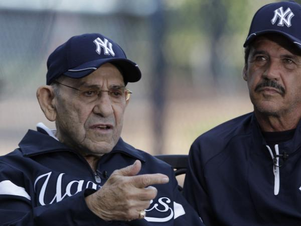 Yogi Berra (left) and Ron Guidry are interviewed before a spring training baseball game between the Yankees and the Washington Nationals at Steinbrenner Field in Tampa, Fla., on March 16.