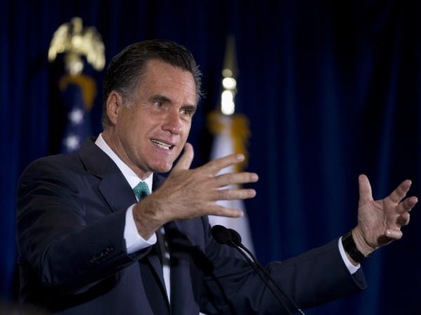 Republican presidential candidate Mitt Romney speaks in San Diego on Monday. Democrats have criticized his support for GOP Rep. Paul Ryan's budget plan.