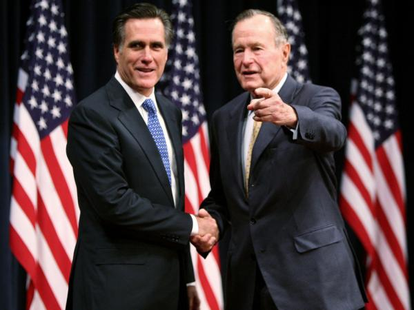 Mitt Romney (left) and former President George H.W. Bush in 2007.