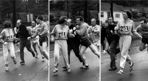 Kathrine Switzer of Syracuse found herself about to be thrown out of the normally all-male Boston Marathon when a husky companion, Thomas Miller of Syracuse, threw a block that tossed a race official out of the running instead.