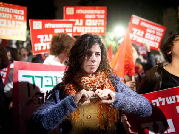 People demonstrate against a possible Israeli military attack and war with Iran on March 24, 2012 in Tel Aviv, Israel. As the balance between war and diplomacy continually teeters, Israel's leaders are afraid that a nuclear-armed Iran is an existential threat.