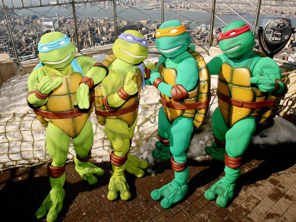 In this photo released by Warner Brothers Pictures, actors portraying the Teenage Mutant Ninja Turtles are photographed on the observation deck of the Empire State Building in New York in 2007, prior to the release of the feature film <em>TMNT</em>.