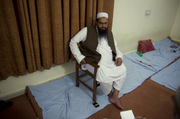 Hafiz Mohammad Saeed, chief of Jamaat-ud-Dawwa and founder of Lashkar-e-Taiba, listens to a reporter during his interview with the Associated Press in Islamabad, Pakistan on Tuesday.