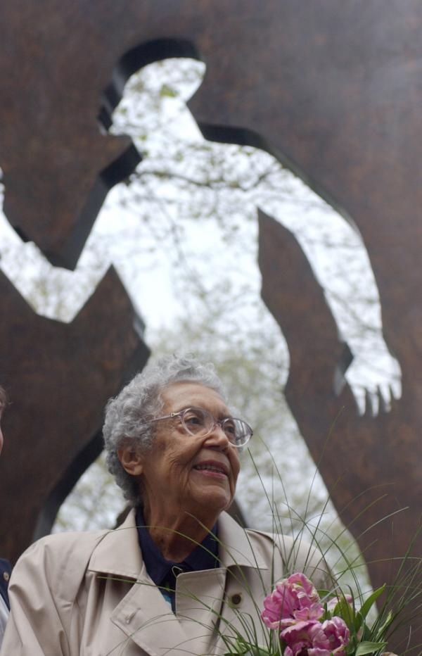 Sculptor Elizabeth Catlett shown in front of her <em>Invisible Man</em> sculpture in New York City in 2003.