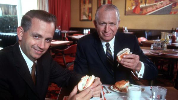 J.W. Marriott dines with his son Bill in a Hot Shoppe in March 1969. The elder Marriott was close to Mitt Romney's father, George.