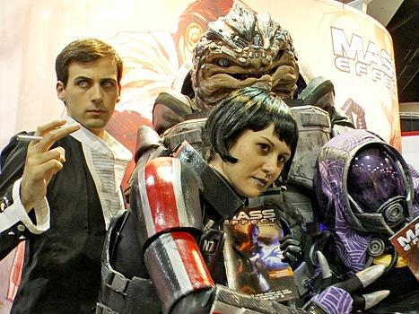 Costume designer Holly Conrad (center) poses with some of her own creations inspired by the popular video game <em>Mass Effect.</em>
