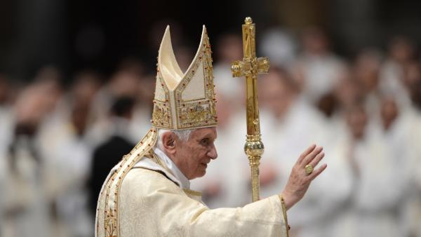 Pope Benedict XVI waves as he leaves at the end of the Chrismal mass in the morning of Holy Thursday on Thursday.