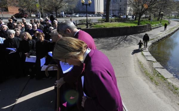 Religious leaders stop to pray as they march to the state Capitol for a rally to support repealing the death penalty, in Hartford, Conn., on Tuesday. The state Senate passed a bill abolishing capital punishment Thursday.