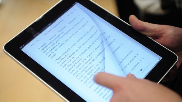 Reading a book on an iPad.