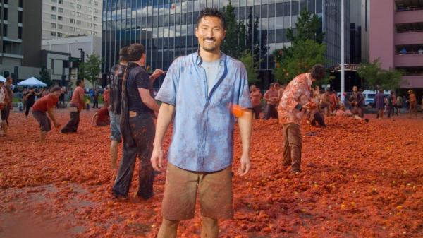 Yul Kwon visits the Reno Tomatina, a giant tomato fight, in the first episode of PBS's <em>America Revealed</em>.