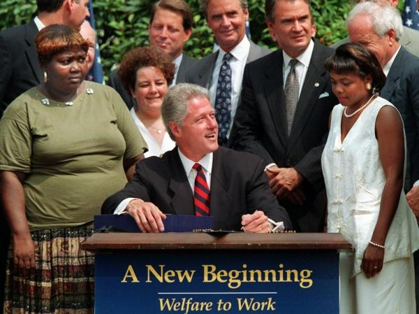 In August 1996, President Clinton prepares to sign legislation overhauling America's welfare system in the Rose Garden of the White House.