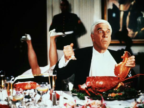 Leslie Nielsen takes a bite out of crime in <em>Naked Gun 2 1/2 — The Smell Of Fear</em>.