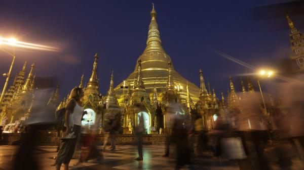 A foreigner pauses to look at the glittering Shwedagon Pagoda, a famous landmark in Myanmar, in Yangon in February. The country's tourism industry is racing to keep up with the rush of visitors now that Myanmar is opening to the outside world.
