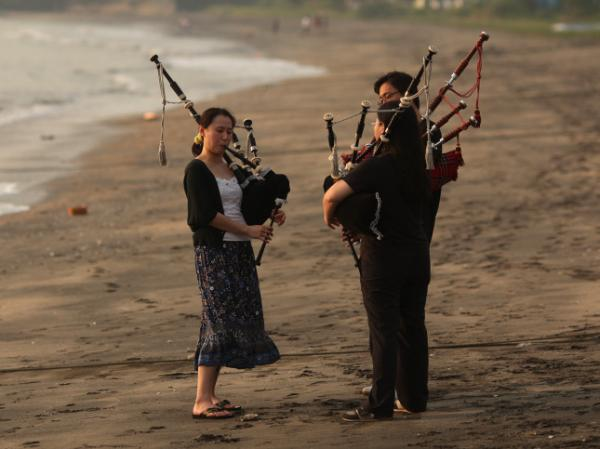 Women practicing bagpipes on a beach in Hong Kong, where the instrument has gained a loyal following. (File photo from October 2011)