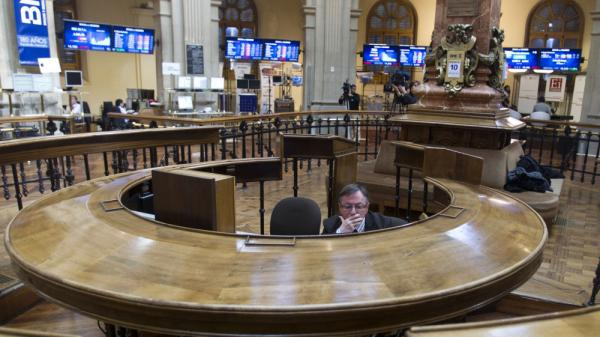 A broker sits in the stock exchange in Madrid. Worries about Spain's finances intensified last week as the country's bond yields rose on international markets, making it more expensive for Spain to borrow money.