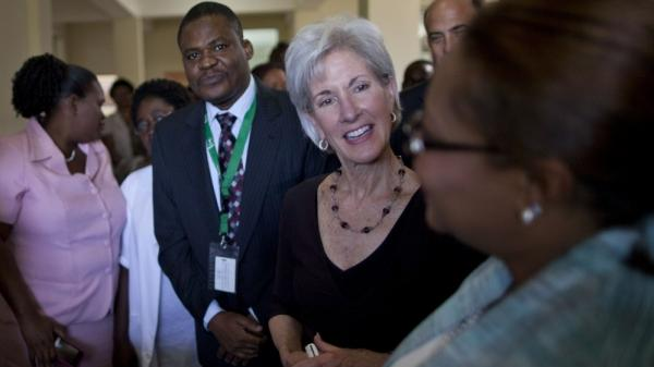 U.S. Secretary of Health and Human Services Kathleen Sebelius (center) talks to a health worker during a visit to Eliazar Germain hospital in Port-au-Prince, Haiti, on Monday. It's Sebelius' first visit to the country.