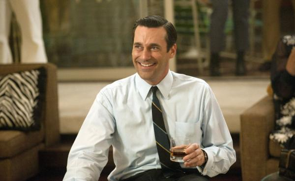 Actor Jon Hamm in a scene from AMC's <em>Mad Men</em>. The show is set in the 1960s — but today, many companies provide their employees with ready access to alcohol.