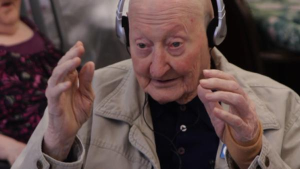Joe, a nursing home resident, broke into song during a personalized music session. His story and others are documented in the film <em>Alive Inside</em>.