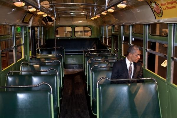 President Barack Obama sits on the famed Rosa Parks bus at the Henry Ford Museum following an event in Dearborn, Mich. on Wednesday.