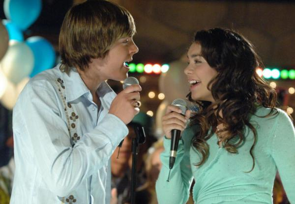 Actors Zac Efron, as basketball star Troy, left, and Vanessa Anne Hudgens, as the shy academic Gabriella, in <em>High School Musical</em>, seen in this undated photo released by the Disney Channel.