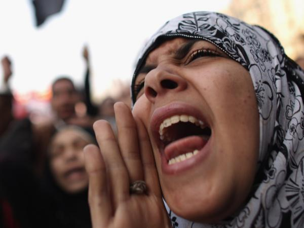 A woman speaks as Egyptians gather in Tahrir Square to mark the one year anniversary of the revolution on Jan.25, 2012 in Cairo, Egypt.