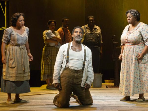 In <em>Porgy and Bess,</em> Serena (Bryonha Marie Parham) and Maria (NaTasha Yvette Williams) give Porgy (Norm Lewis) some distressing news. The show is is playing at the Richard Rodgers Theatre.