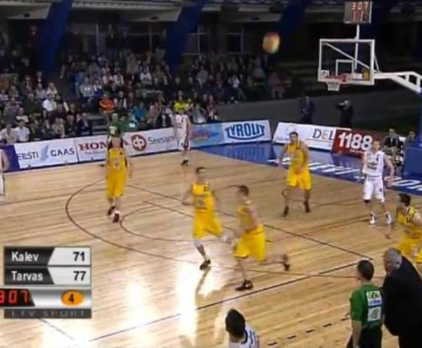 Armands Skele (at bottom, in the center of this screen grab) flipped the ball backhand toward the basket. And in it went.