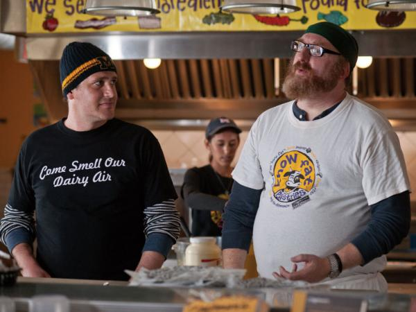 Tom makes the best of the relocation by making unlikely friends like Tarquin (Brian Posehn) and trying to find work as a chef — while in the meantime putting in time at Ann Arbor's famed Zingerman's Deli.