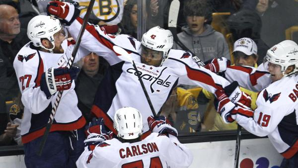 Washington Capitals right wing Joel Ward, center, is mobbed by teammates after his game-winning goal against the Boston Bruins.