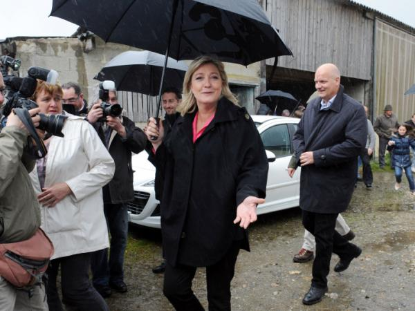 President of French far-right party National Front and former candidate for the 2012 French presidential election, Marine Le Pen visits a dairy farm as part of her campaign on April 20, 2012 in Merdrignac, western France.