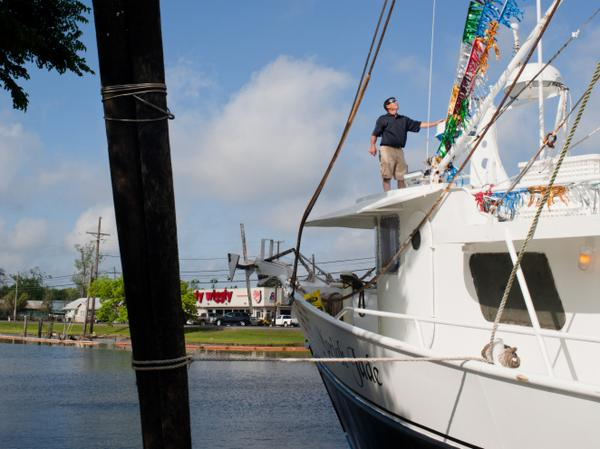 David Chauvin pauses to inspect the decorations on his trawler, the Mariah Jade.